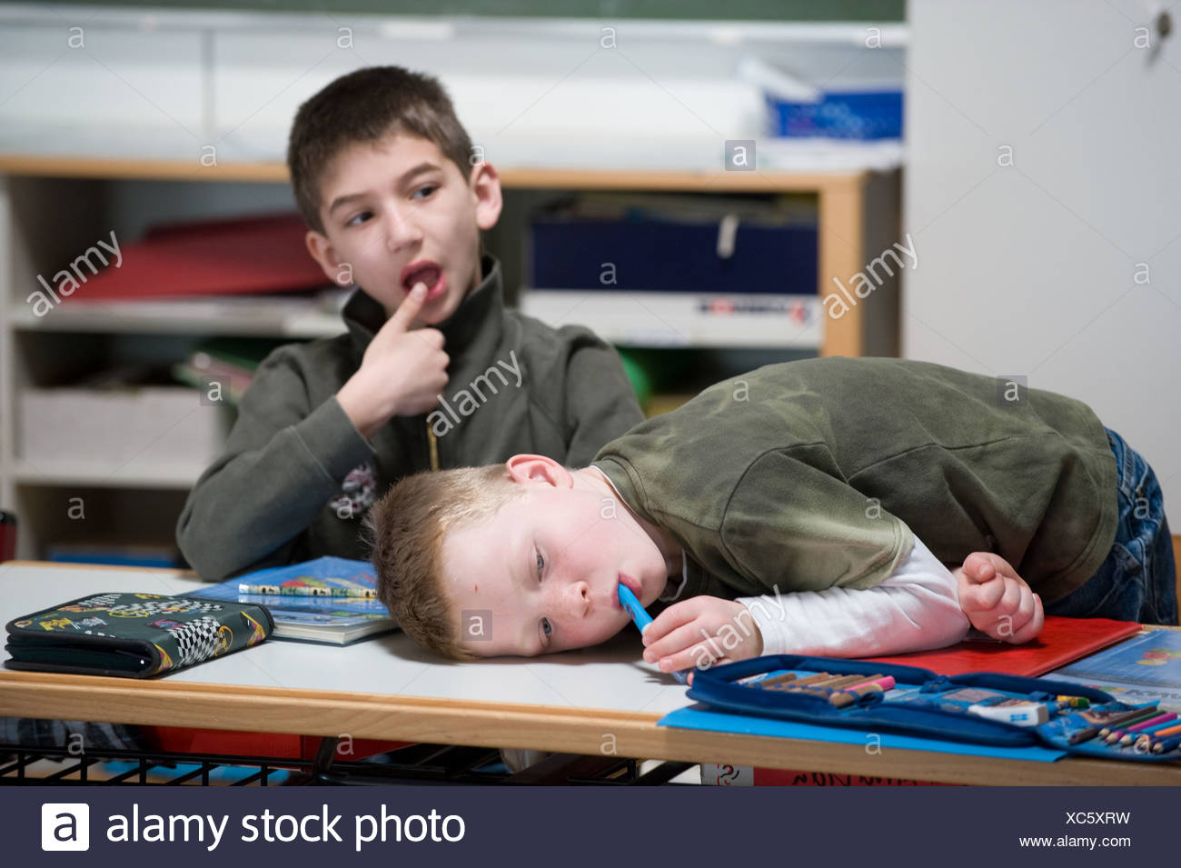 Tuttlingen, Germany, two students try to solve a task - Stock Image