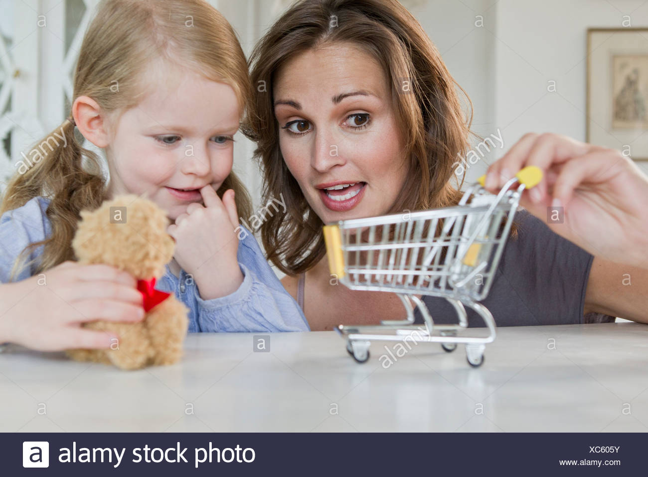Mother and daughter playing with toys - Stock Image