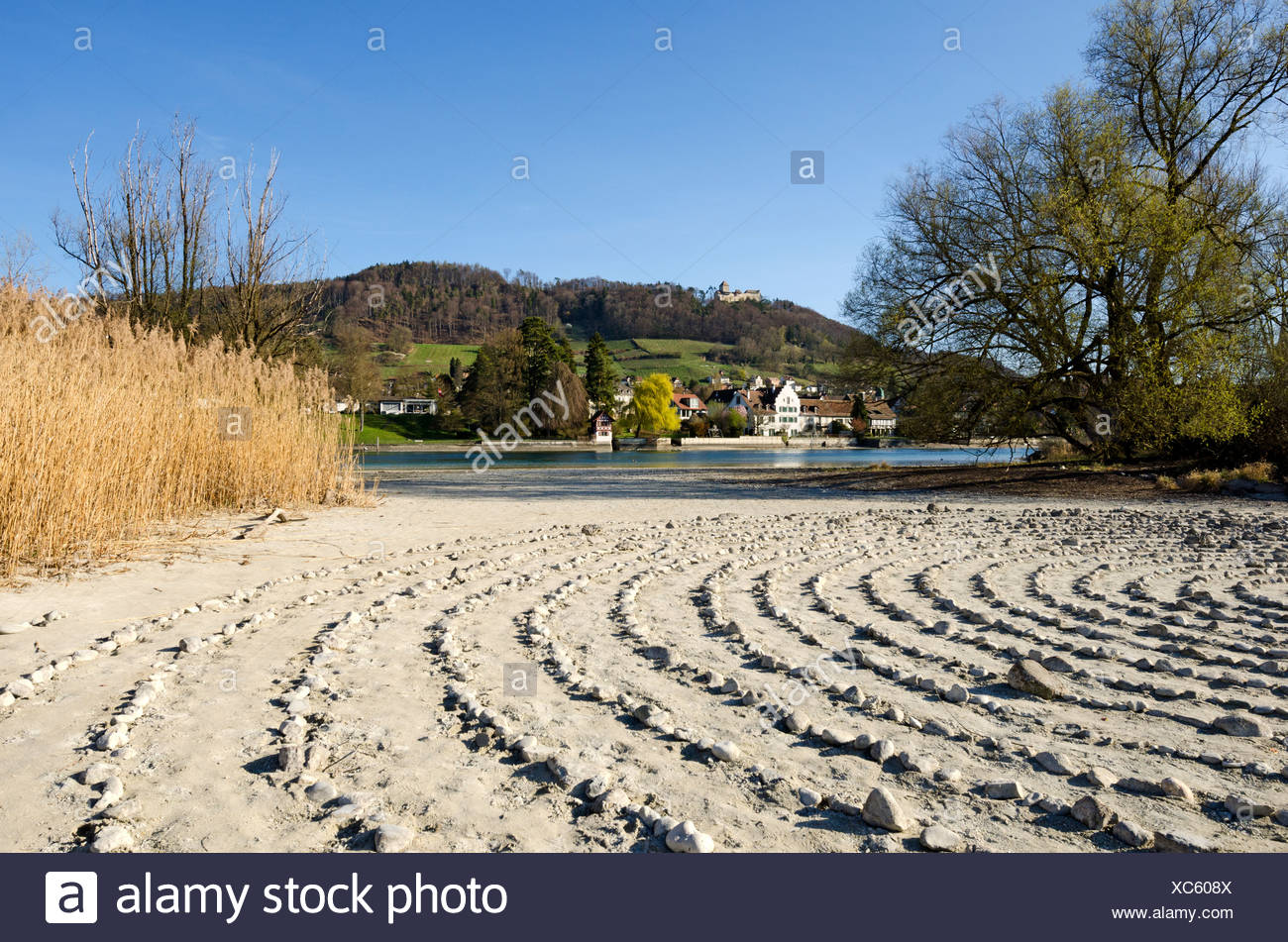 Stone labyrinth on Werd island, can be used for meditation, the historic district of Stein am Rhein and Hohenklingen Castle at - Stock Image
