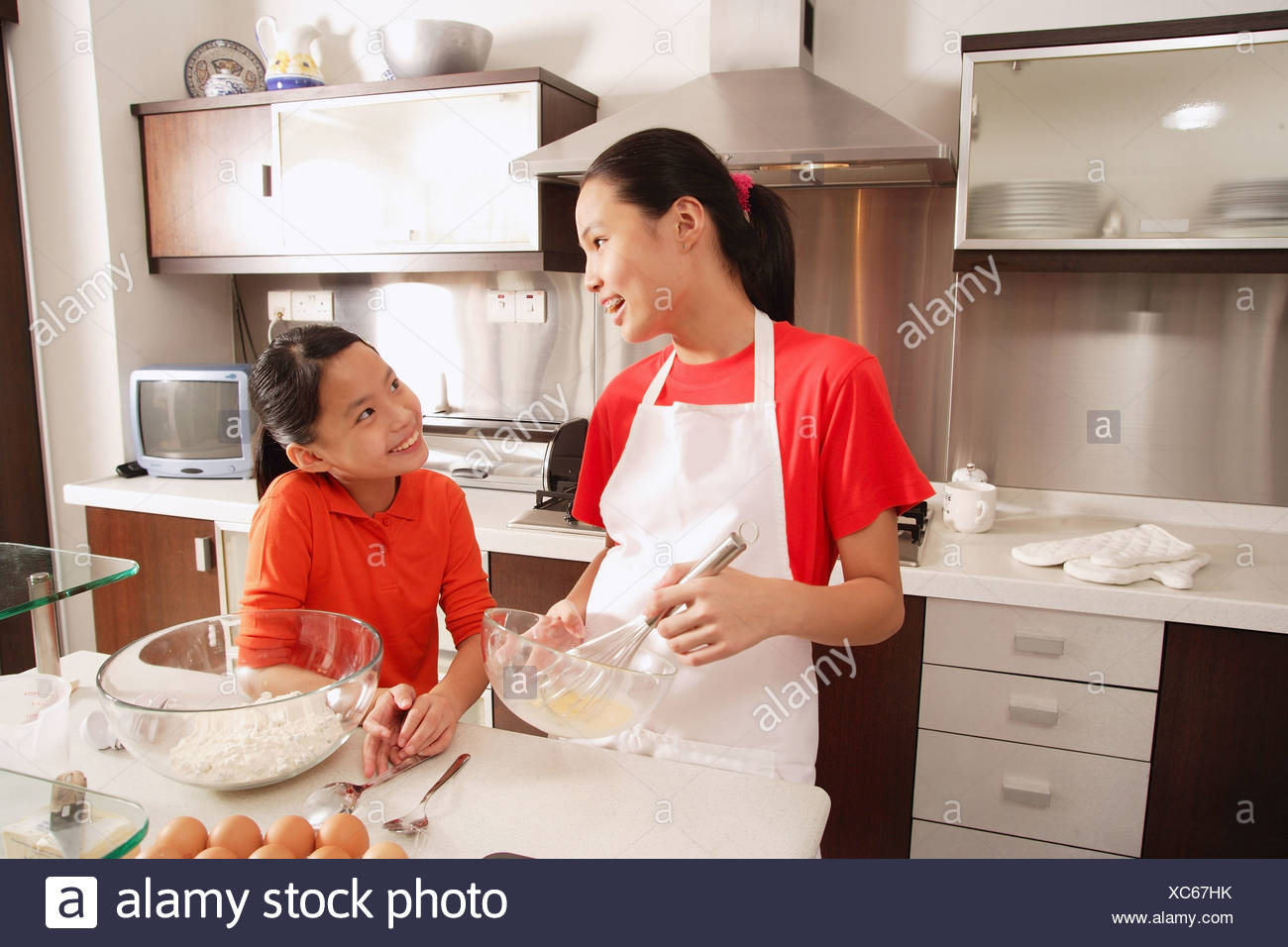 Two sisters baking in kitchen Stock Photo: 282879455 - Alamy