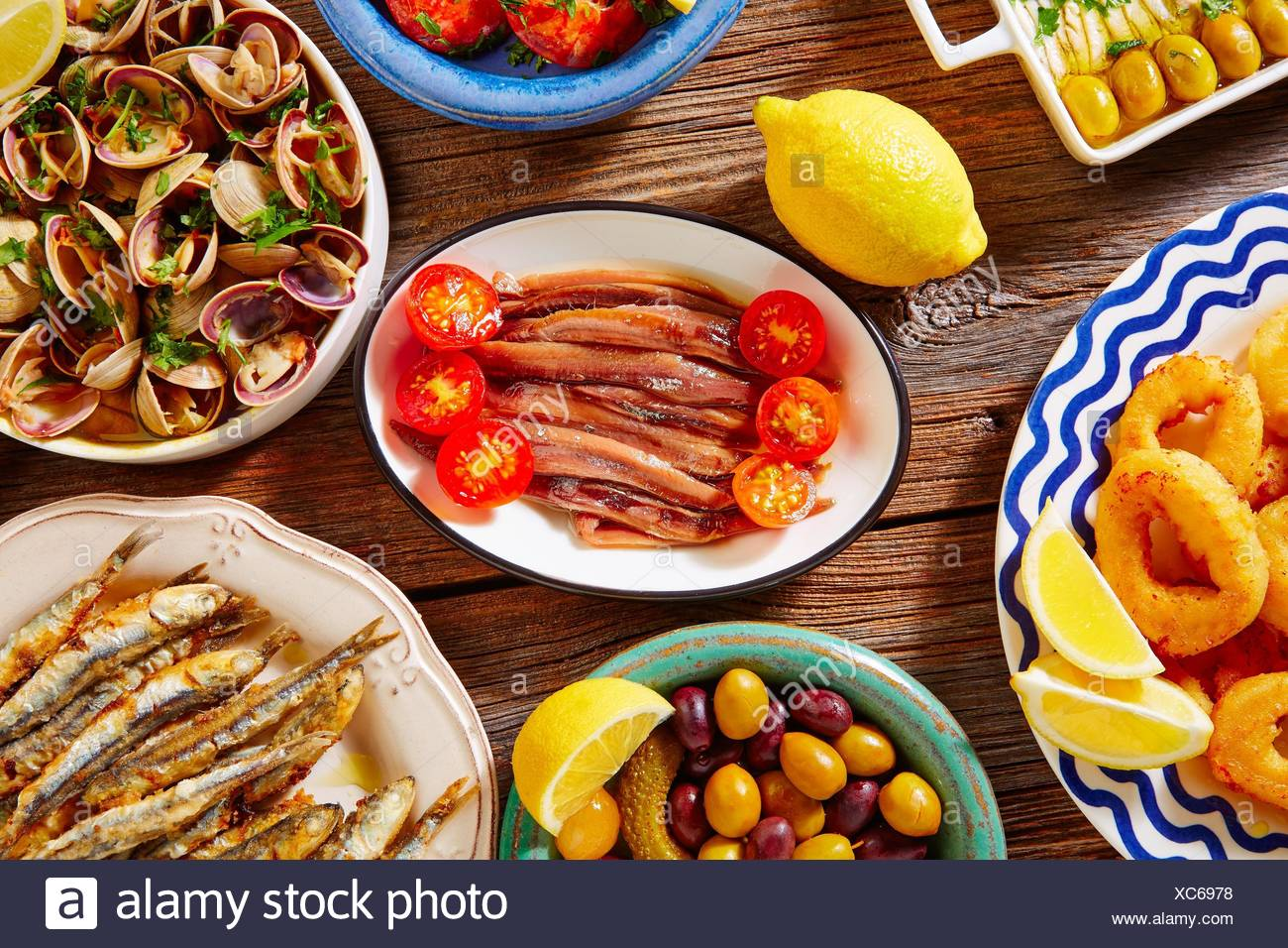 Tapas spanish seafood clams shrimps and fried anchovies fish. - Stock Image