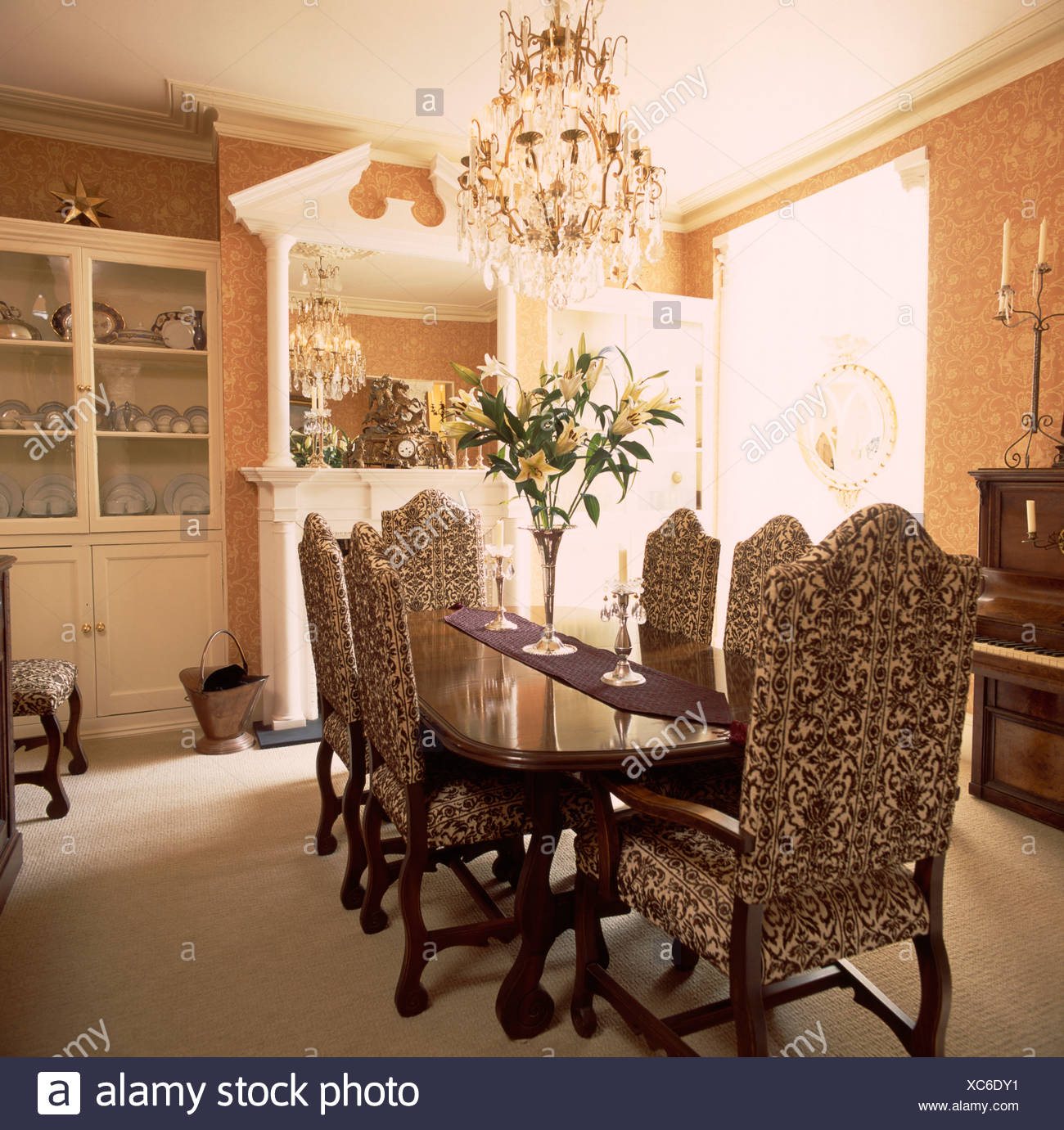 Chandelier Above Tapestry Upholstered Chairs And Mahogany ...