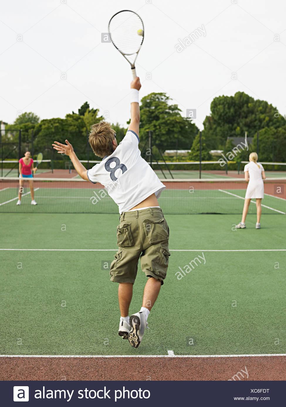 People playing tennis Stock Photo