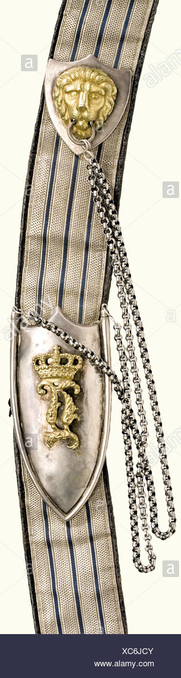 An 1837/1864 officer's pouch, 1st Uhlan Regiment. A leather box covered with black Moroccan leather, silver-plated German silver lid. Includes the bandolier, silver lace with three interwoven light blue threads on black Moroccan leather backing. Chain fastening with a gilded crowned cipher 'L'. Lace is scarcely darkened. Departing from regulation, the officers of the 1st Uhlans initially wore the cartridge box with black instead of red Moroccan leather. Illustrated in 'Dienst und Rangabzeichen der Offiziere und Beamten der bayerischen Armee 1806 - 1918', Seibol, Additional-Rights-Clearances-NA - Stock Image