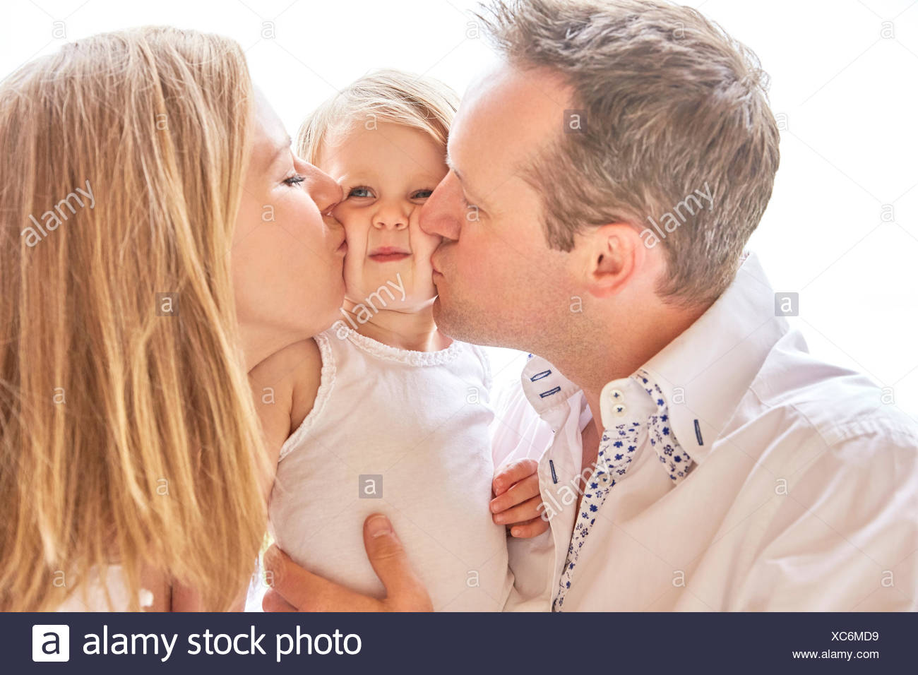 Couple with baby daughter - Stock Image