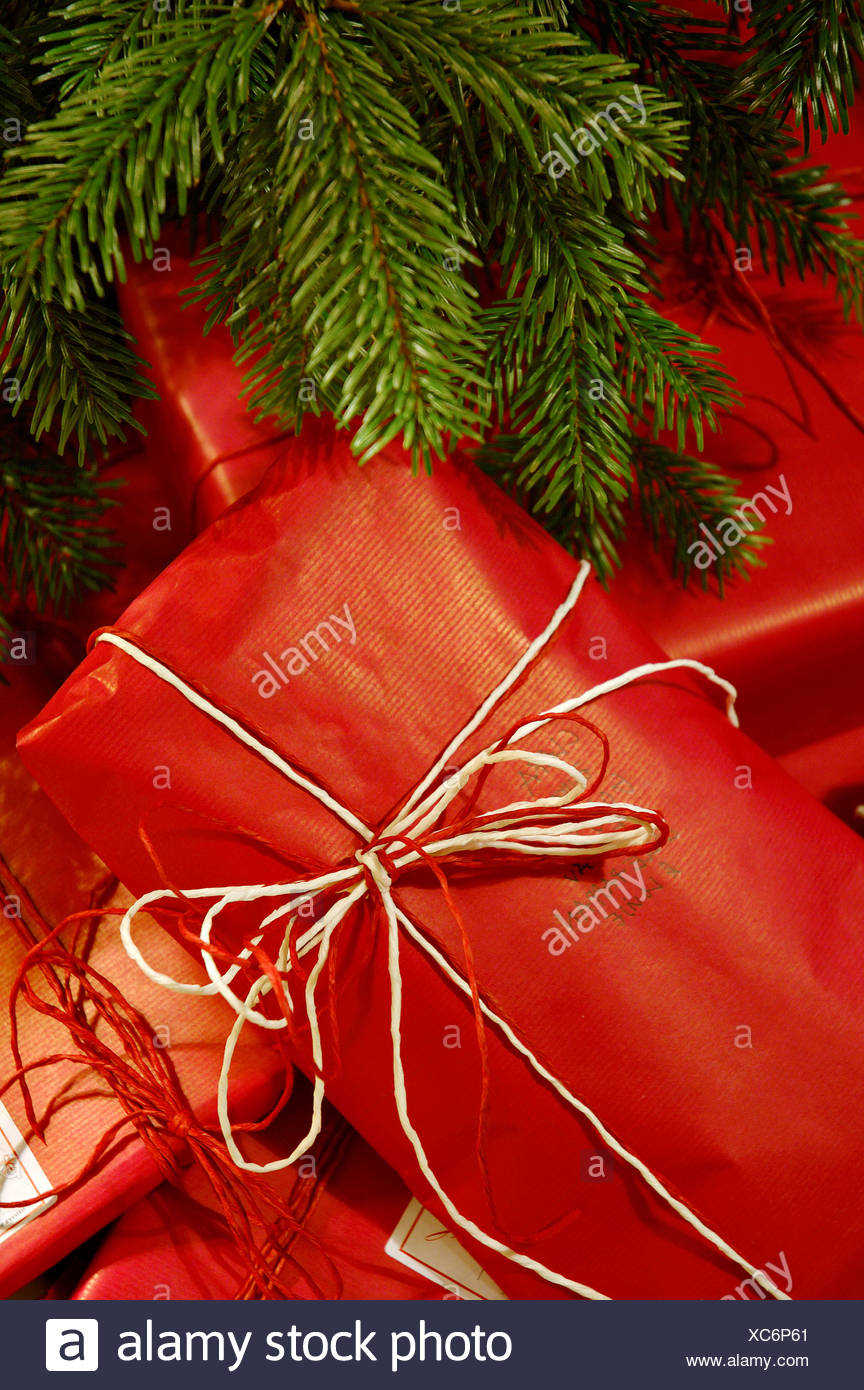 close up of christmas gifts under the tree stock image