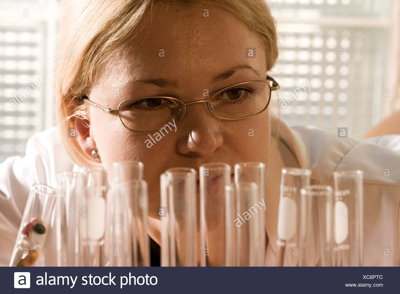 Researcher attempting to discover the cure to save lives or save the environment. - Stock Image