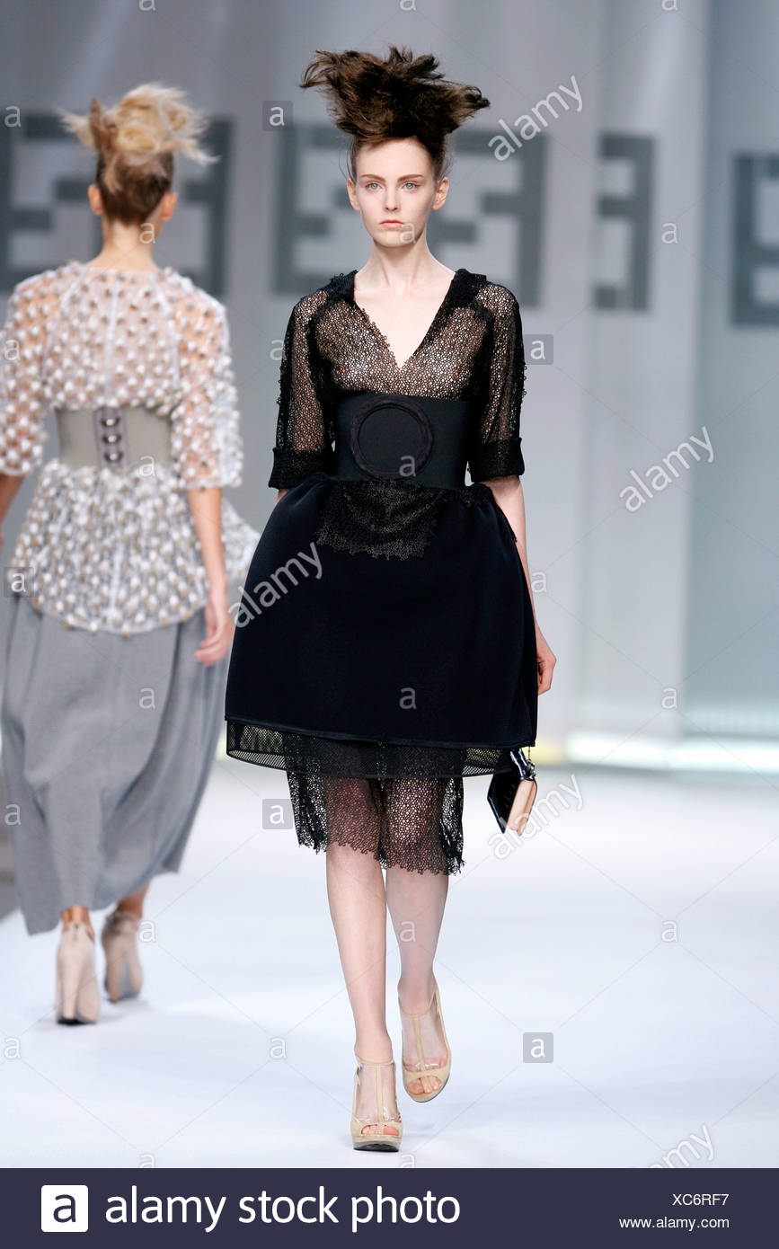 44e6f1e35a7 Fendi Milan Ready to Wear Spring Summer Revealing black lace prom dress  with bird nest hair