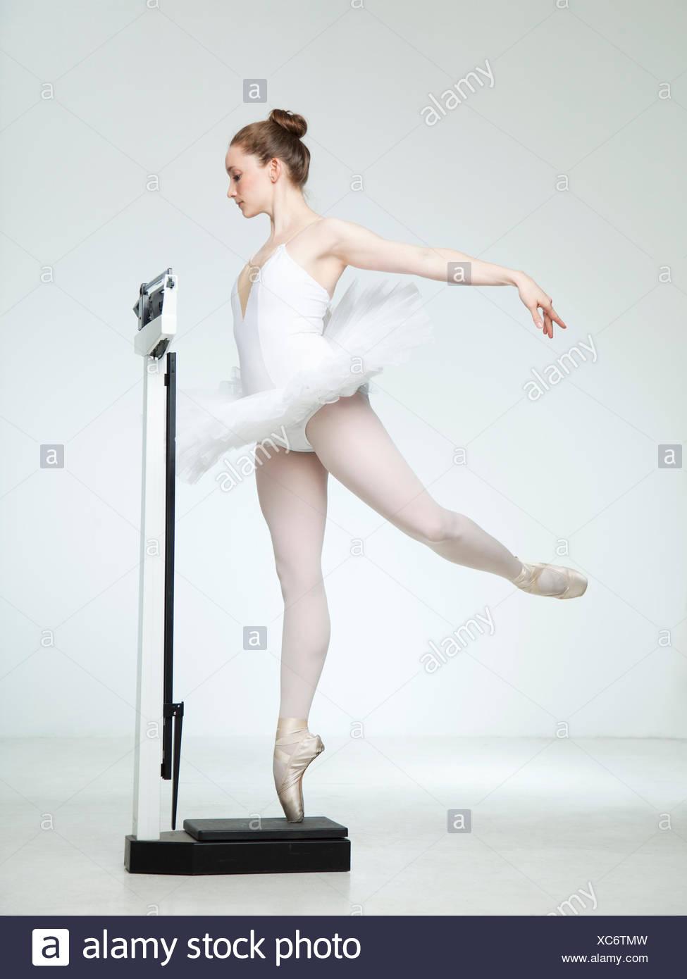 Studio shot of ballet dancer dancing on weight scale Stock Photo - Alamy