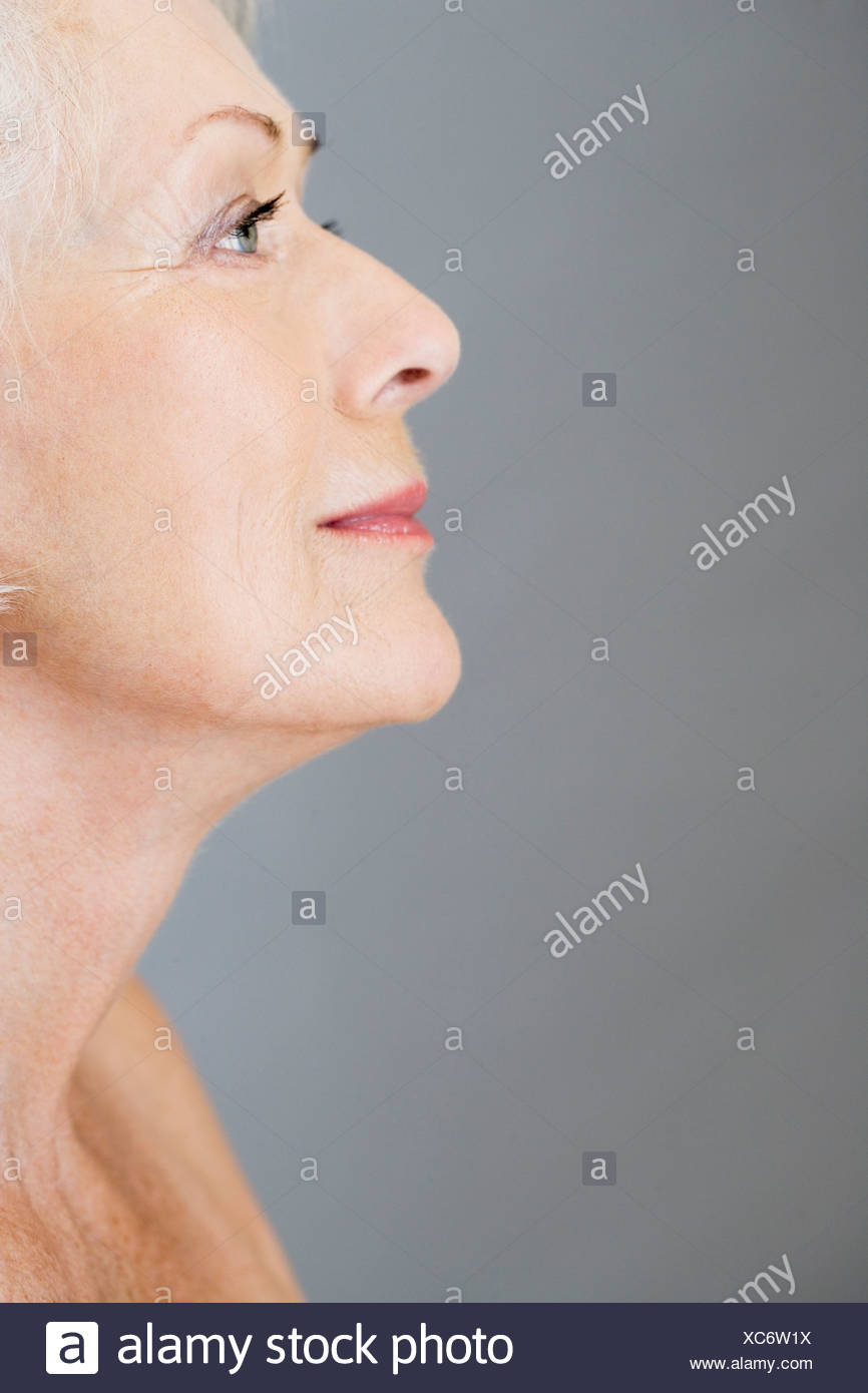 A profile portrait of an attractive senior woman - Stock Image
