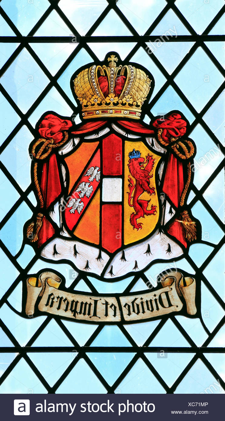Divide et Impera, Divide and Rule, heraldic, motto, heraldry, stained glass window, East Barsham Manor, Norfolk, England, UK - Stock Image