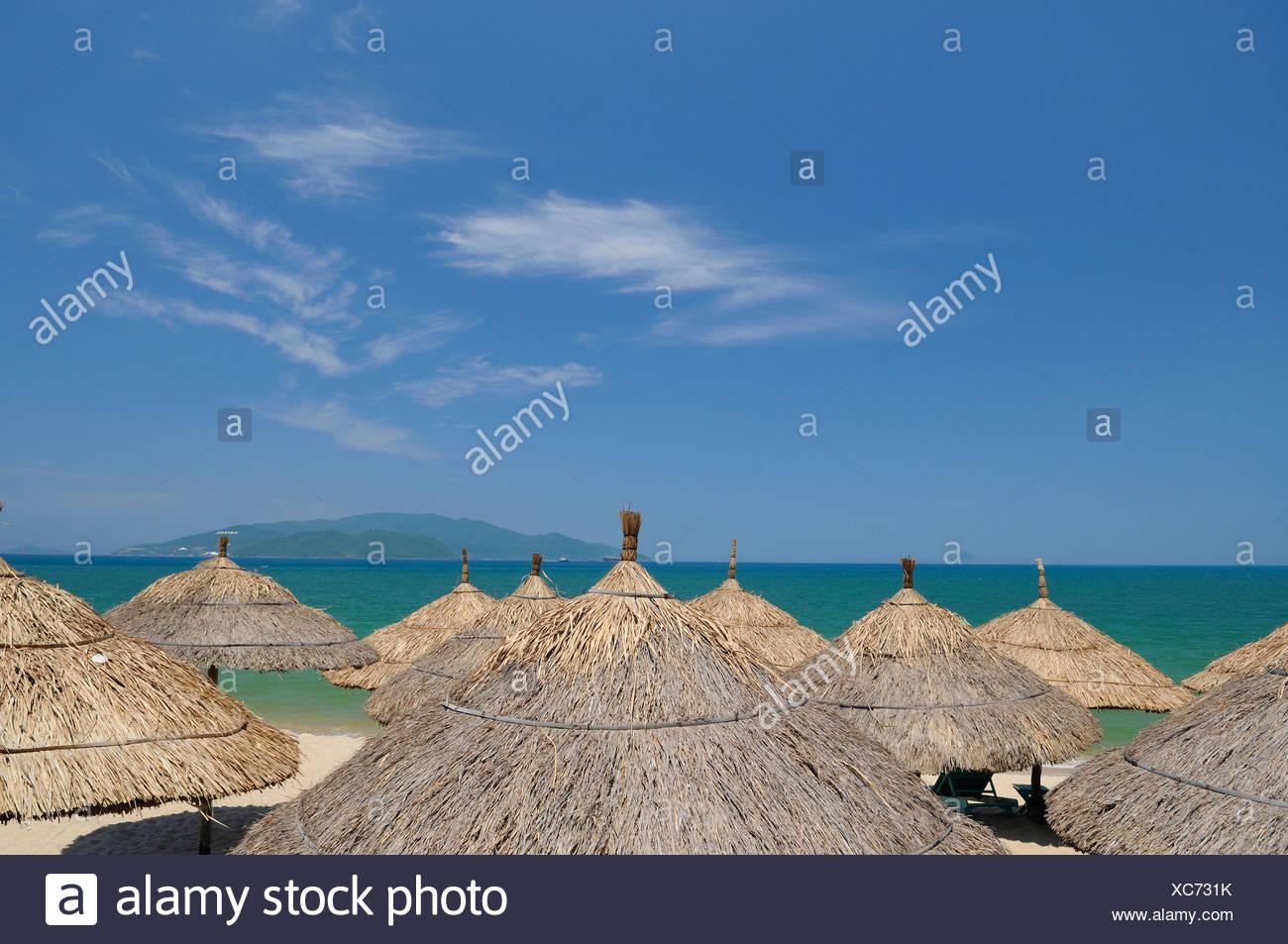 Umbrellas, beach of Nha Trang, Vietnam, Southeast Asia - Stock Image