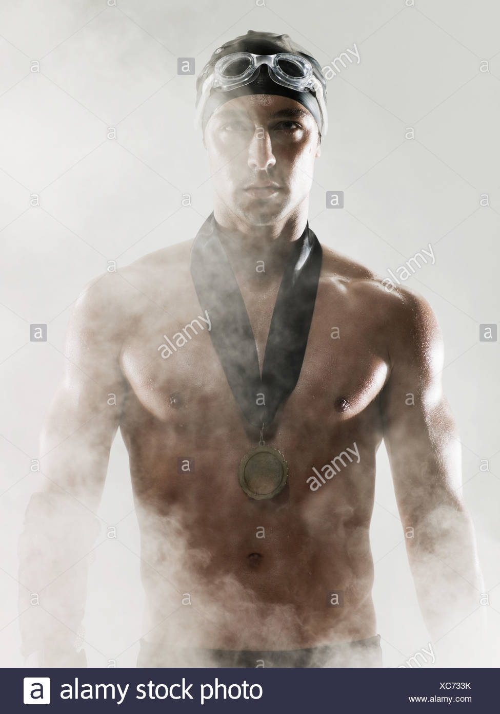 A swimmer wearing a medal - Stock Image