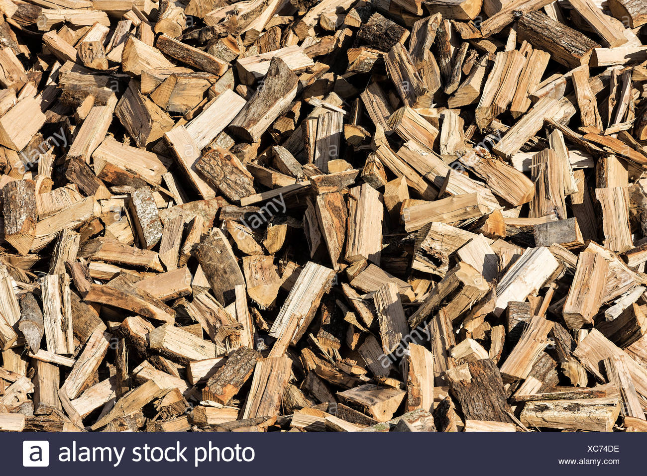 Large stack of split firewood - Stock Image