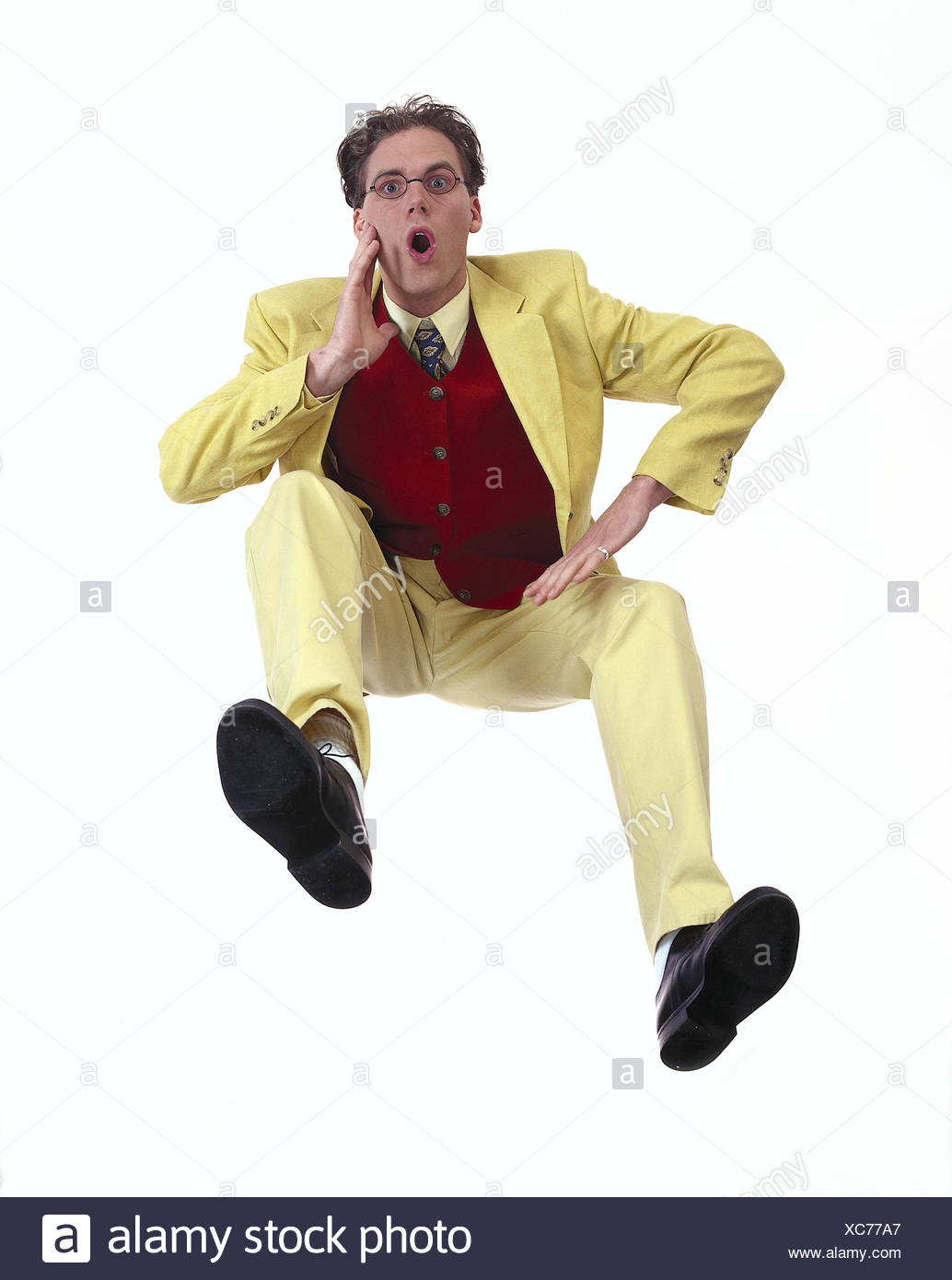 Man, young, to yellow suit, gesture, studio mb 155 A7 - Stock Image