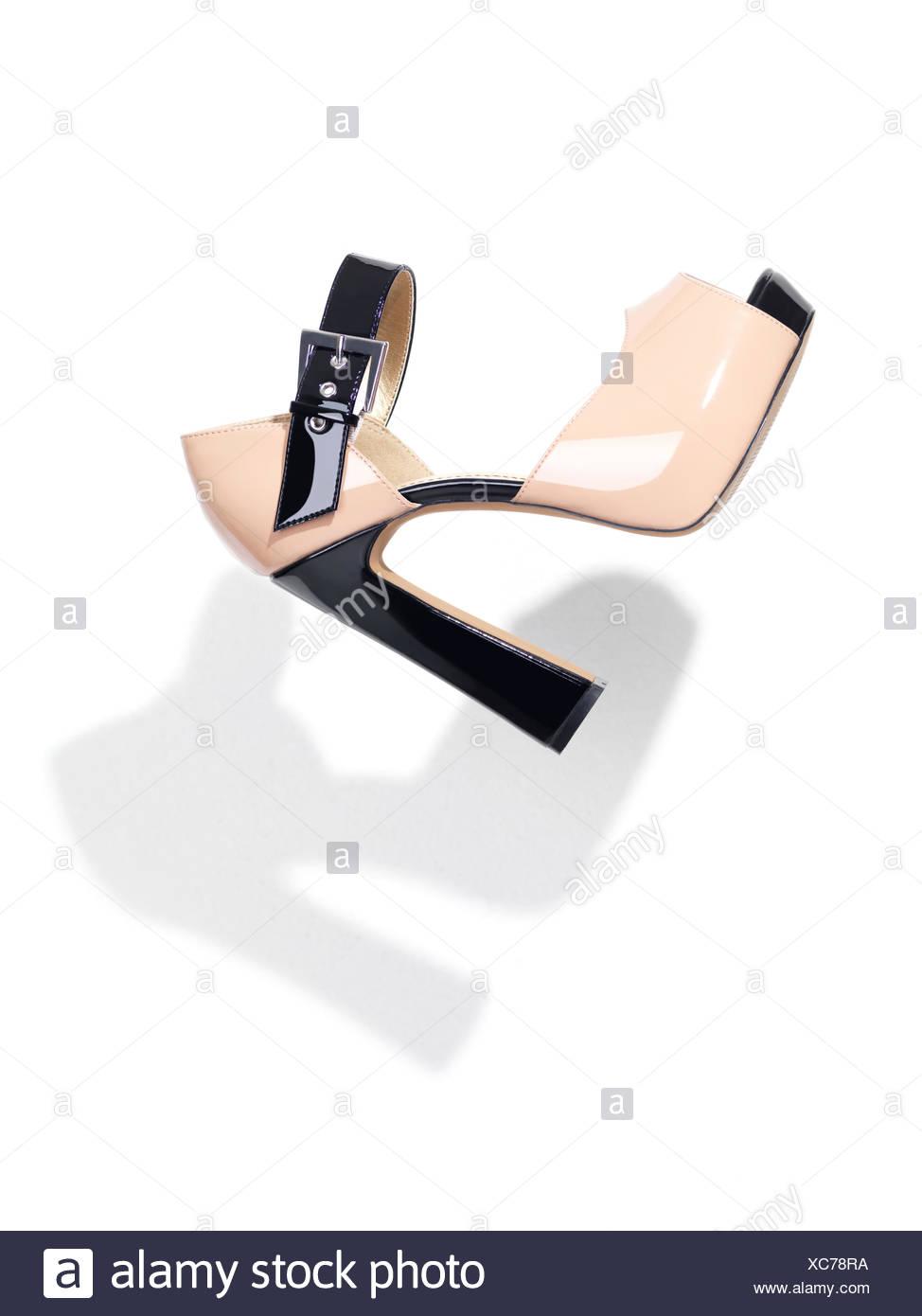 Shiny open-toe high heel shoe - Stock Image
