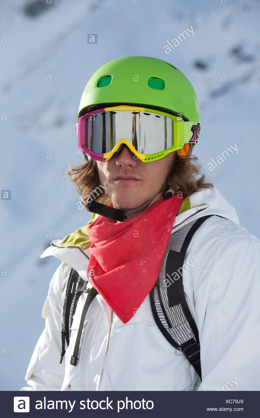 Portrait of man in ski helmet and ski goggles - Stock Image