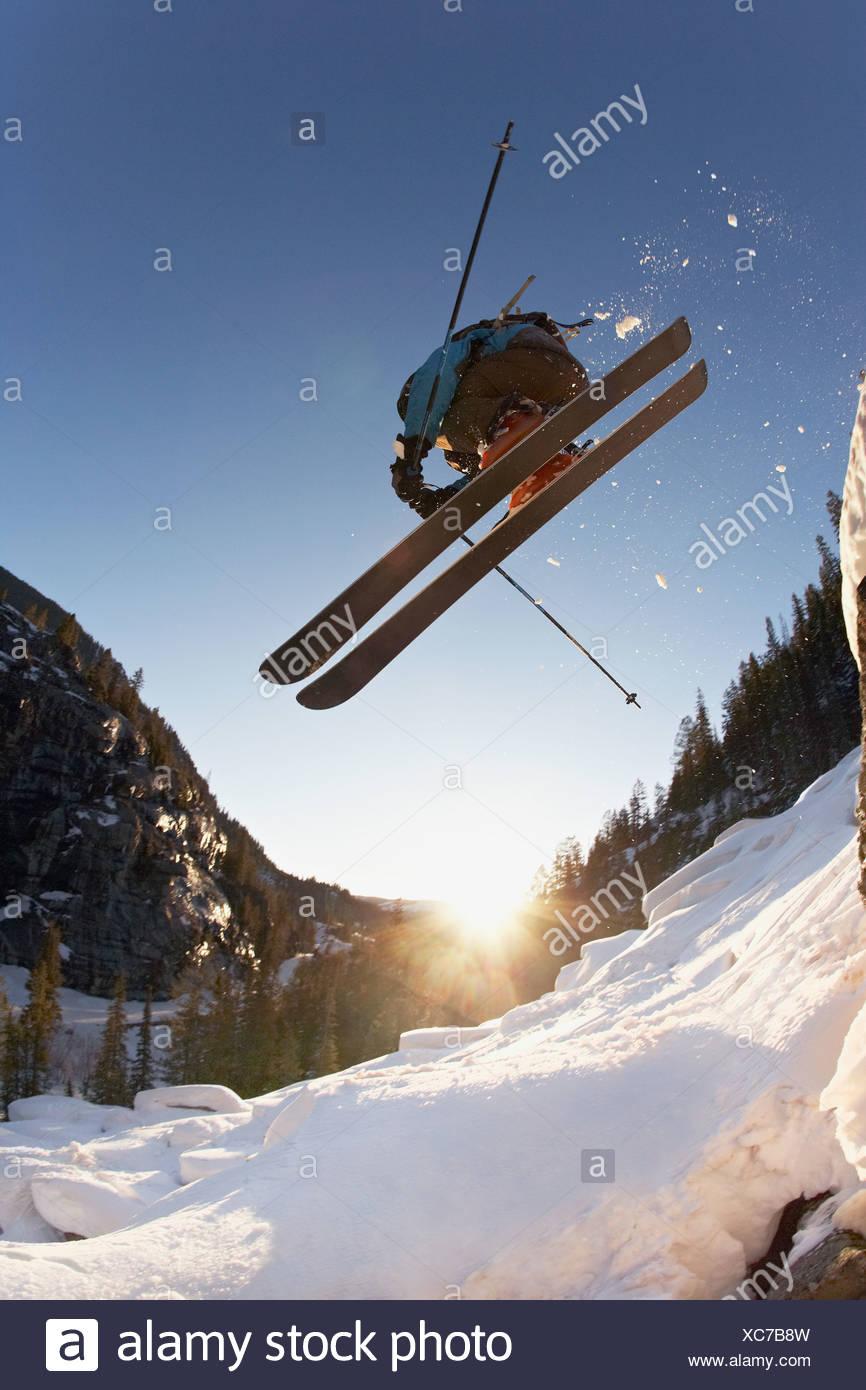 Skier mid jump in Aspen Colorado - Stock Image