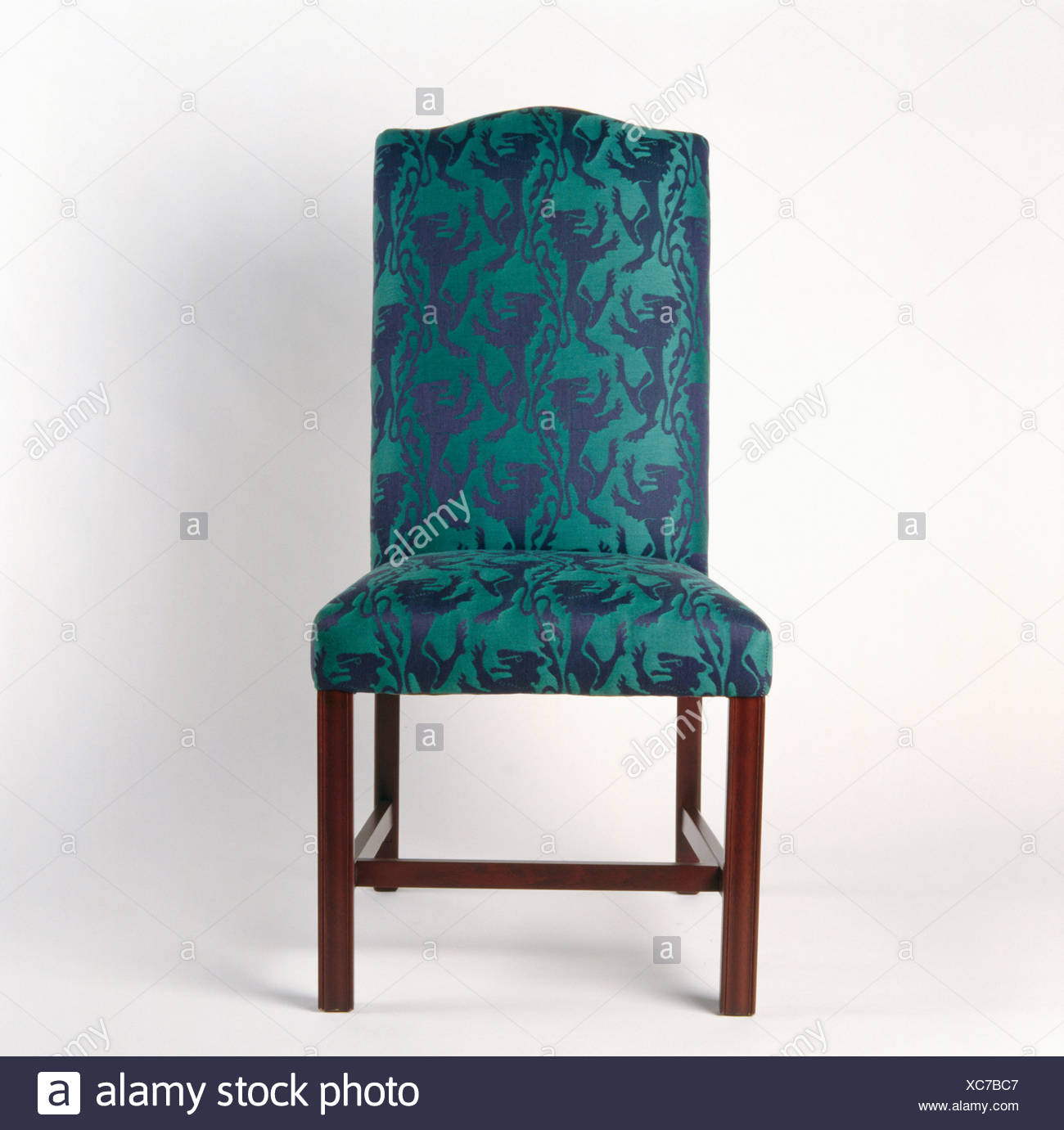 Close-up of green+blue upholstered chair - Stock Image