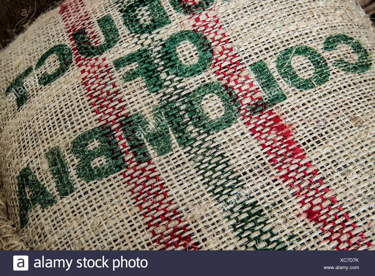 Sacks of coffee beans at a coffee importer's warehouse - Stock Image