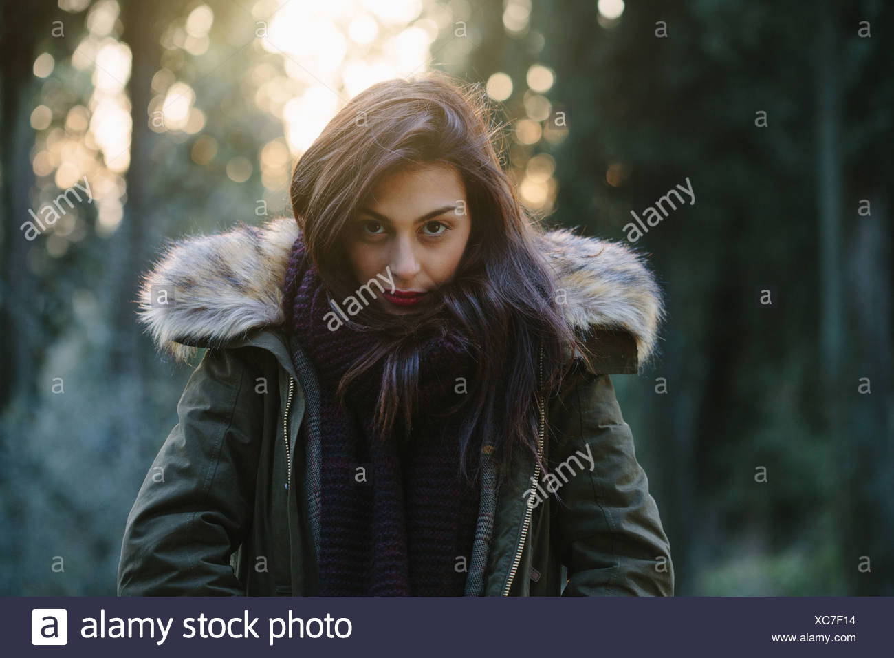 Portrait of attractive young woman in forest - Stock Image