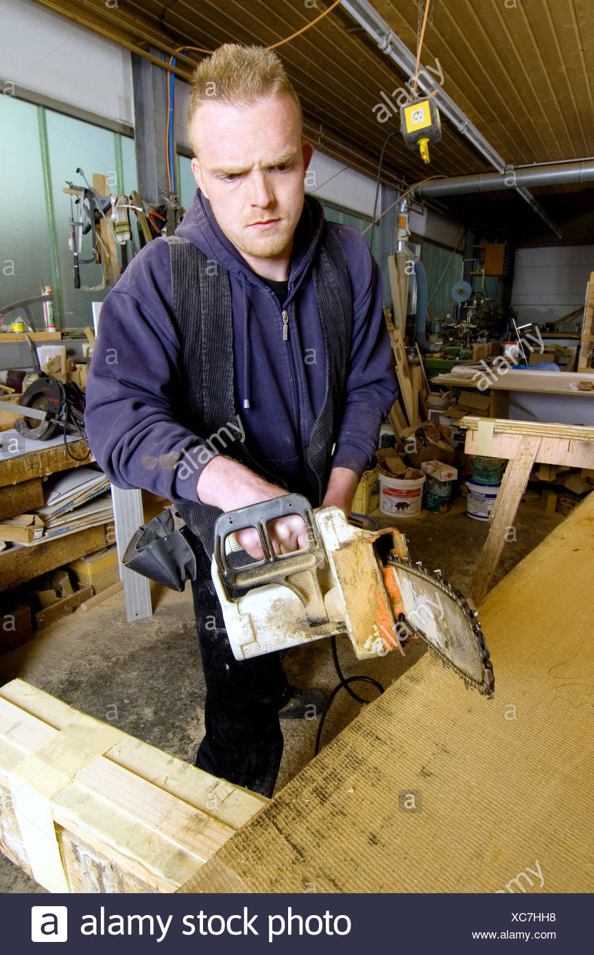 carpenter working with chain saw Stock Photo