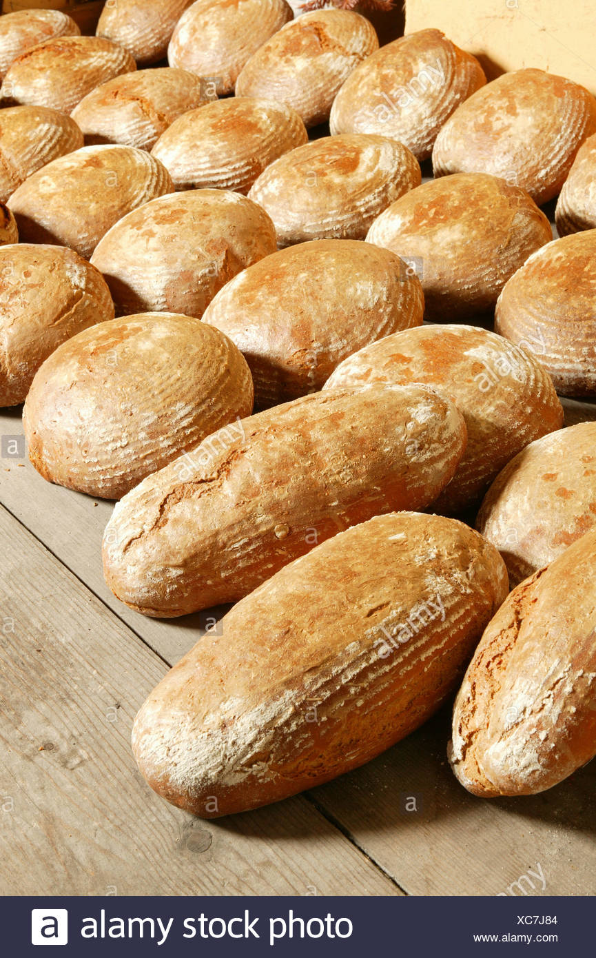 Fresh bread on a wooden board to cool down Stock Photo