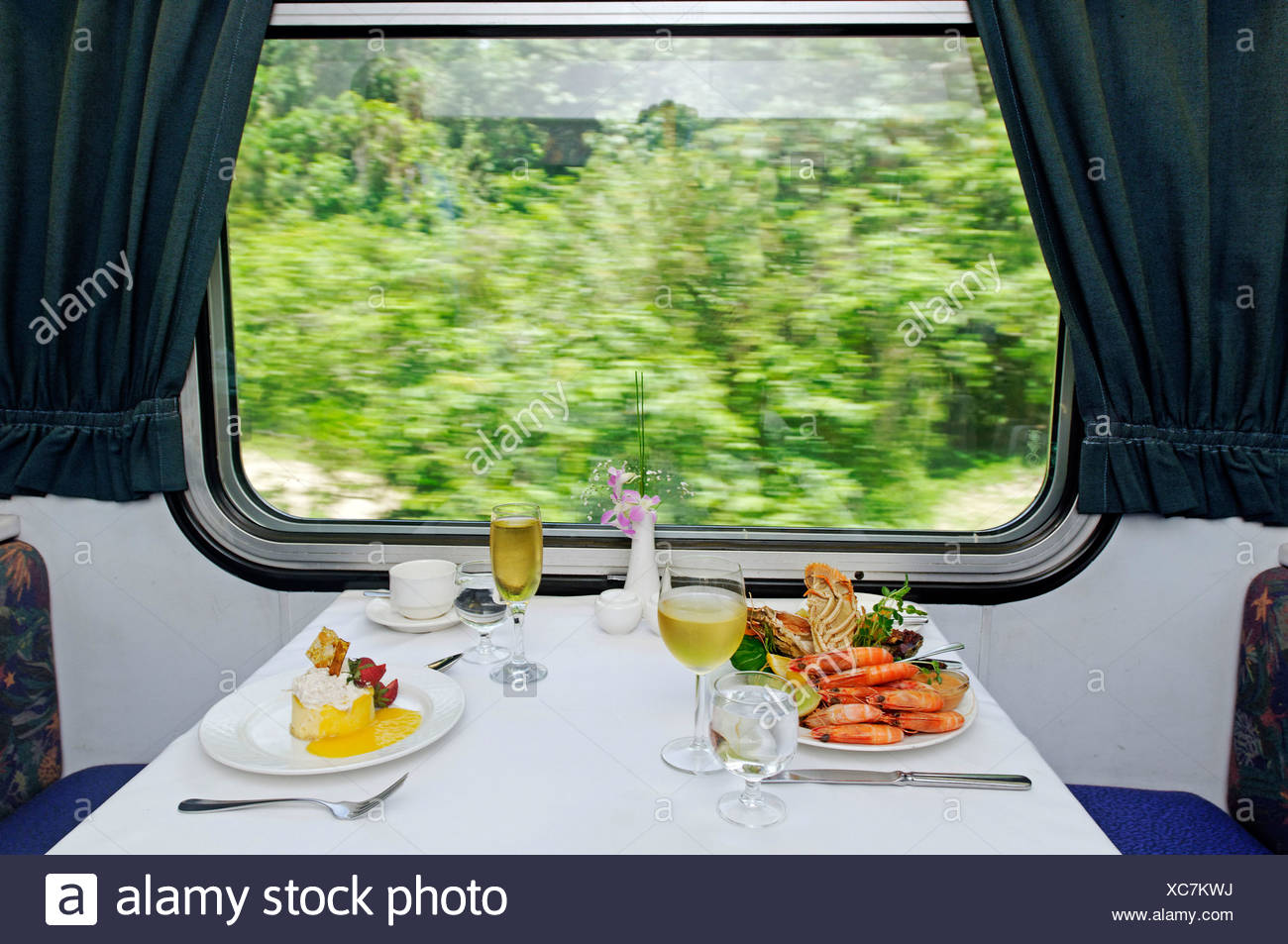 Laid table in the restaurant car of the Sunlander train, Queensland, Australia - Stock Image