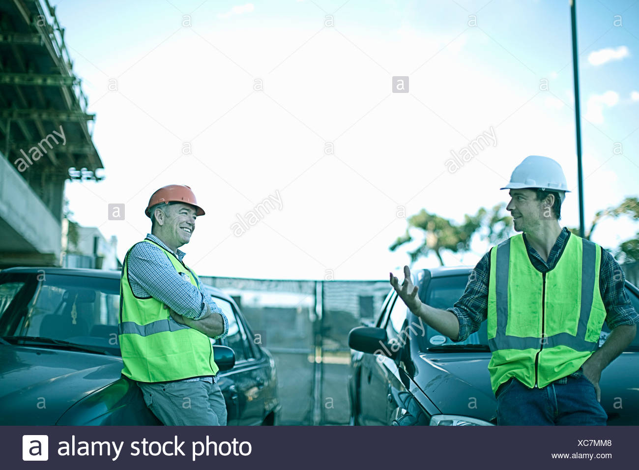 Construction workers talking on site - Stock Image