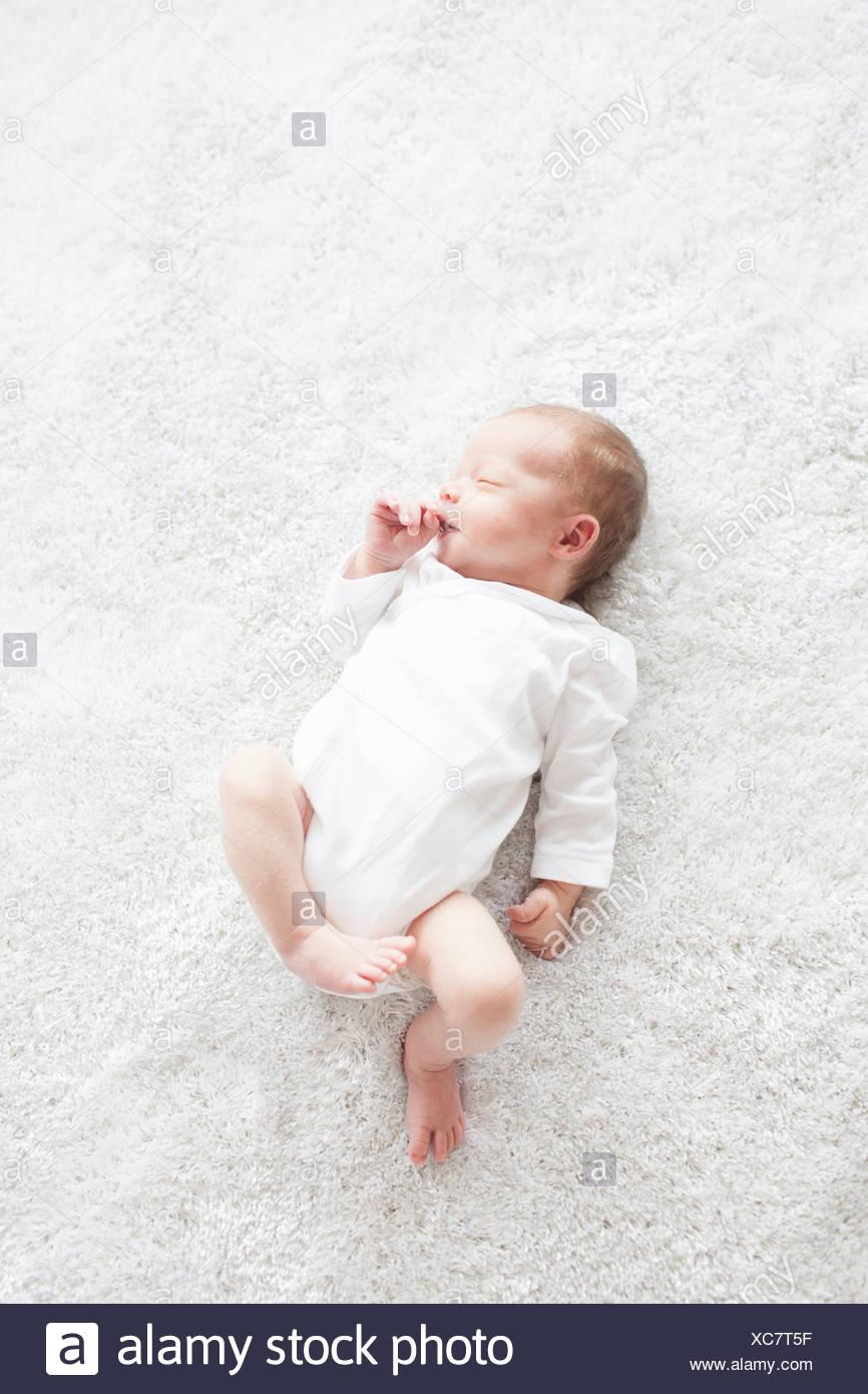 Newborn baby laying asleep - Stock Image