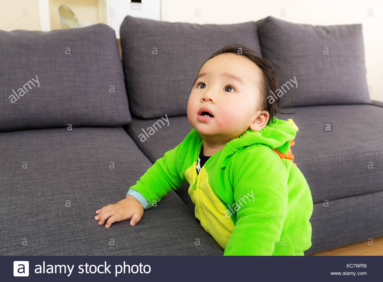 asia baby with dinosaur halloween party costume stock photo
