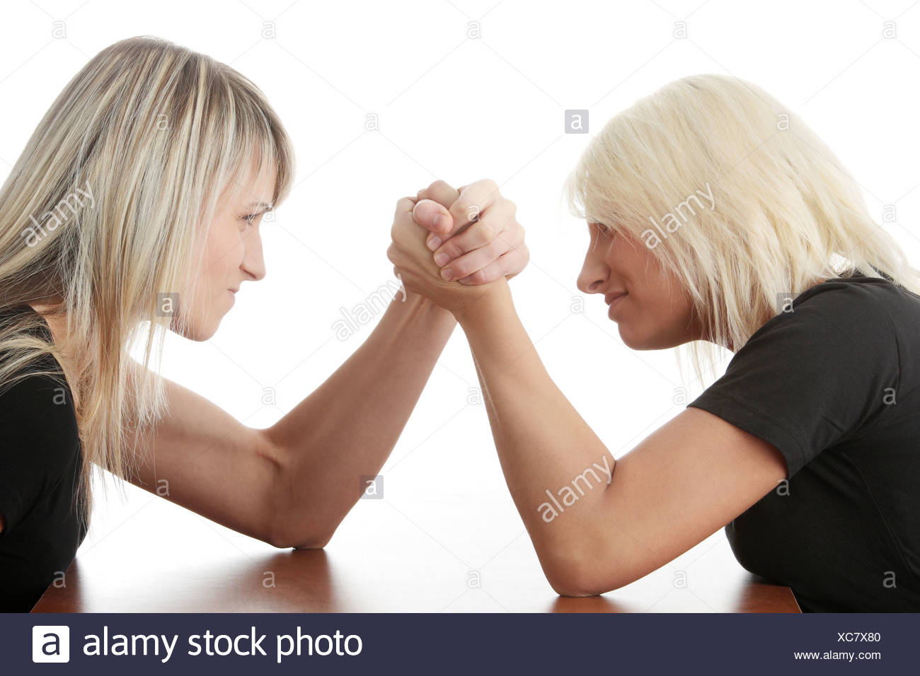Two woman competition. Isolated on white background - Stock Image