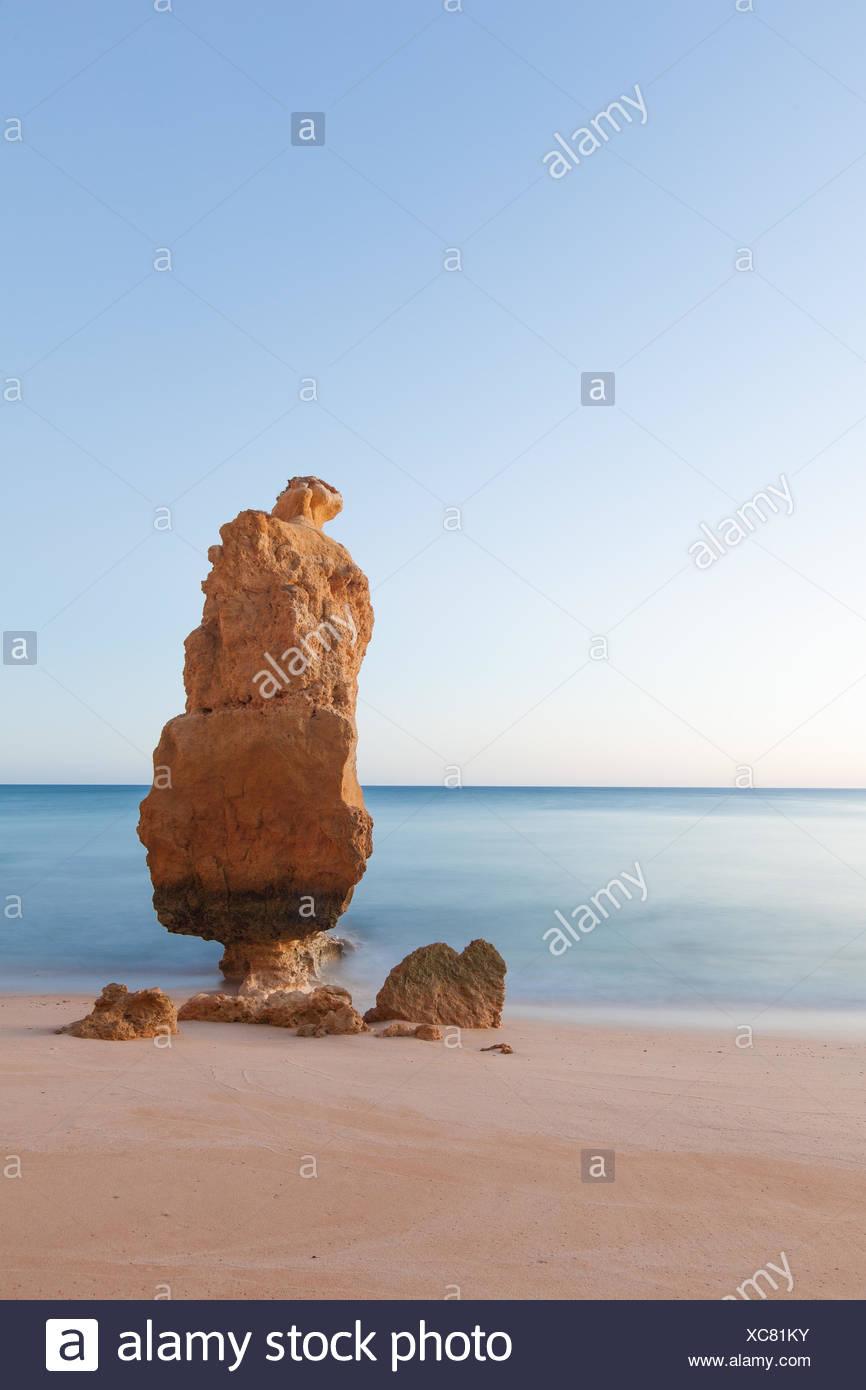 Portugal, Algarve, Praia da Marinha, Stack rock at sandy beach Stock Photo