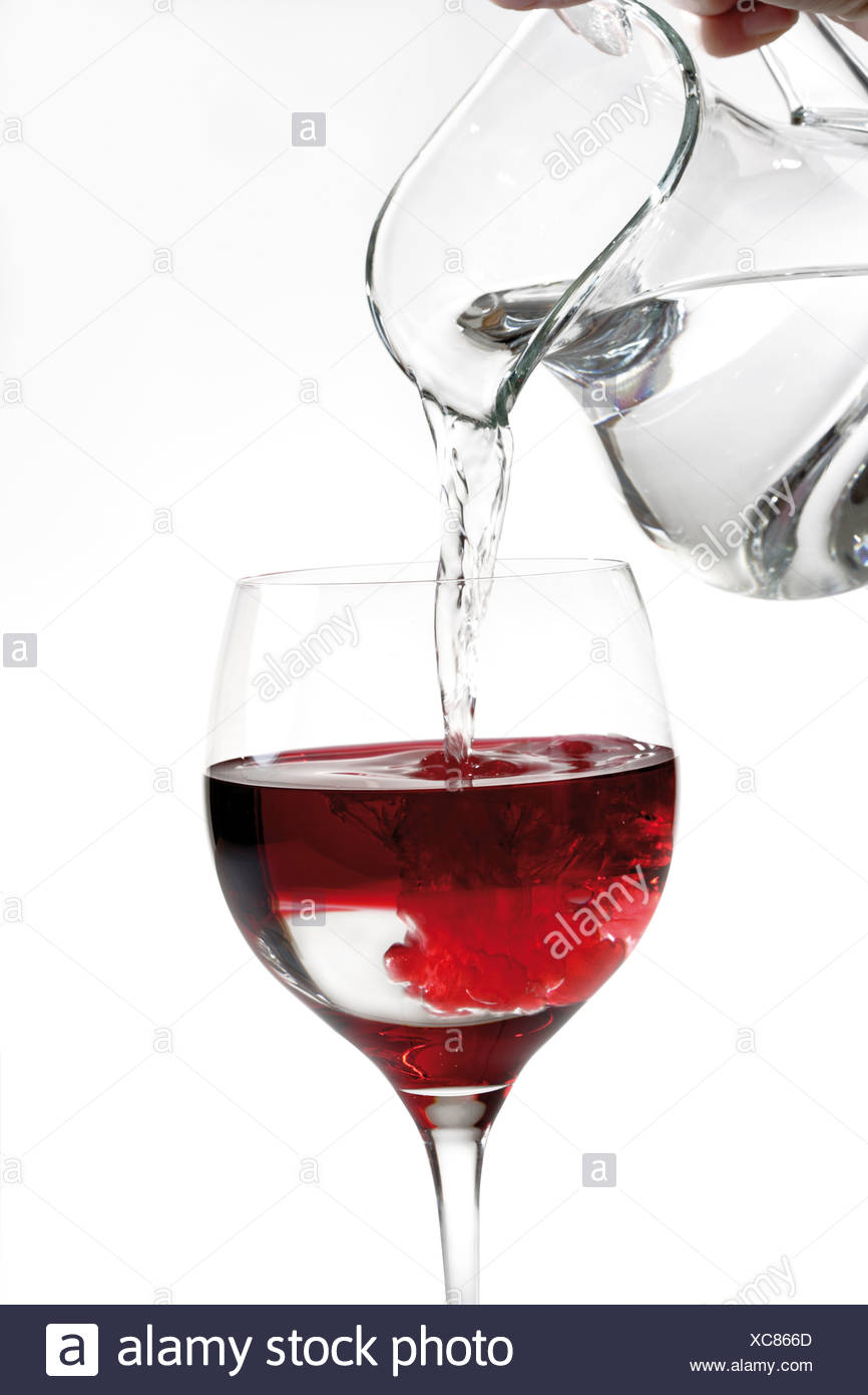 Hand pouring water into wine glass, close-up Stock Photo ...