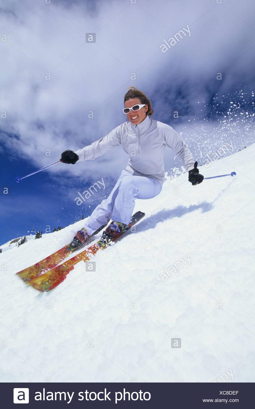 Woman spring skiing in Utah. - Stock Image