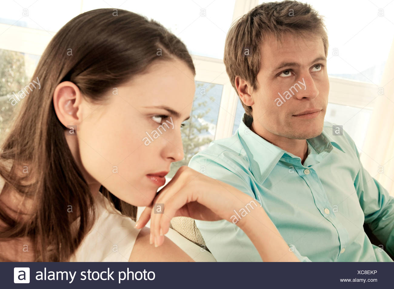 Sulking couple in living-room Stock Photo
