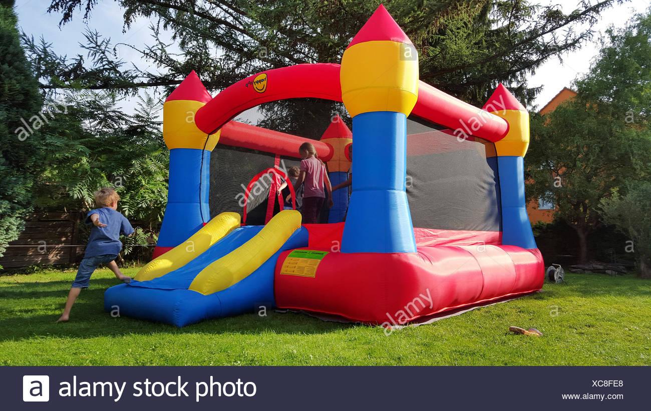 big bouncy castle in a garden, Germany, North Rhine-Westphalia, Ruhr Area, Witten - Stock Image