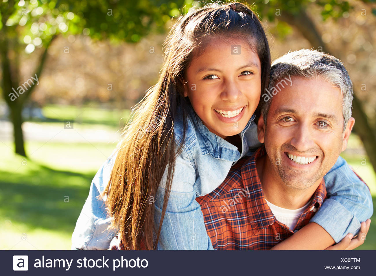Portrait Of Father And Daughter In Countryside - Stock Image