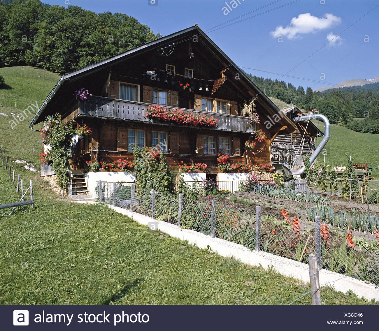 folklore farmhouse mountains farmhouses flowers garden Switzerland Europe - Stock Image