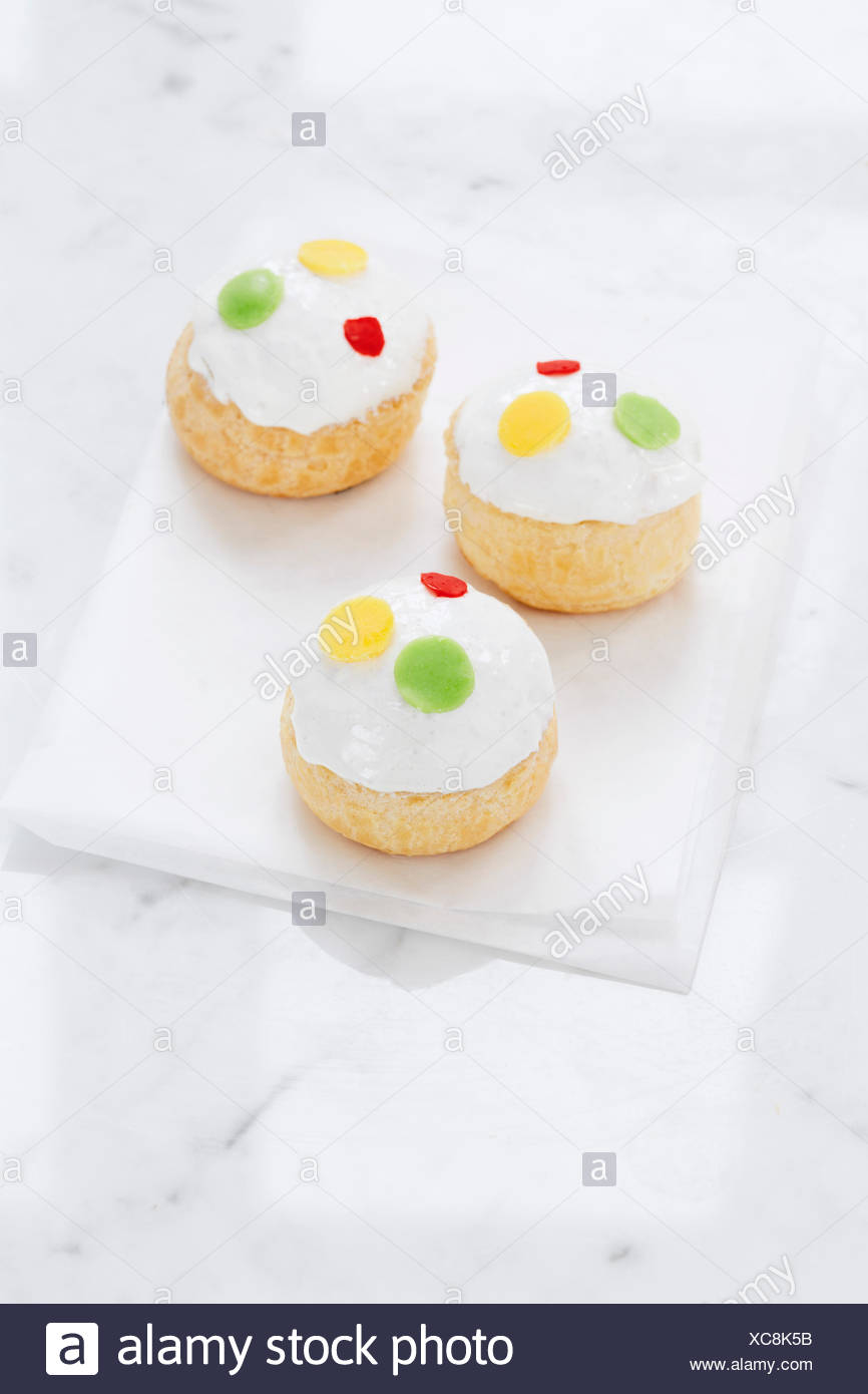 Сhoux pastry with a delicate filling of cheese Mascarpone, vanilla and raspberry coulis. - Stock Image