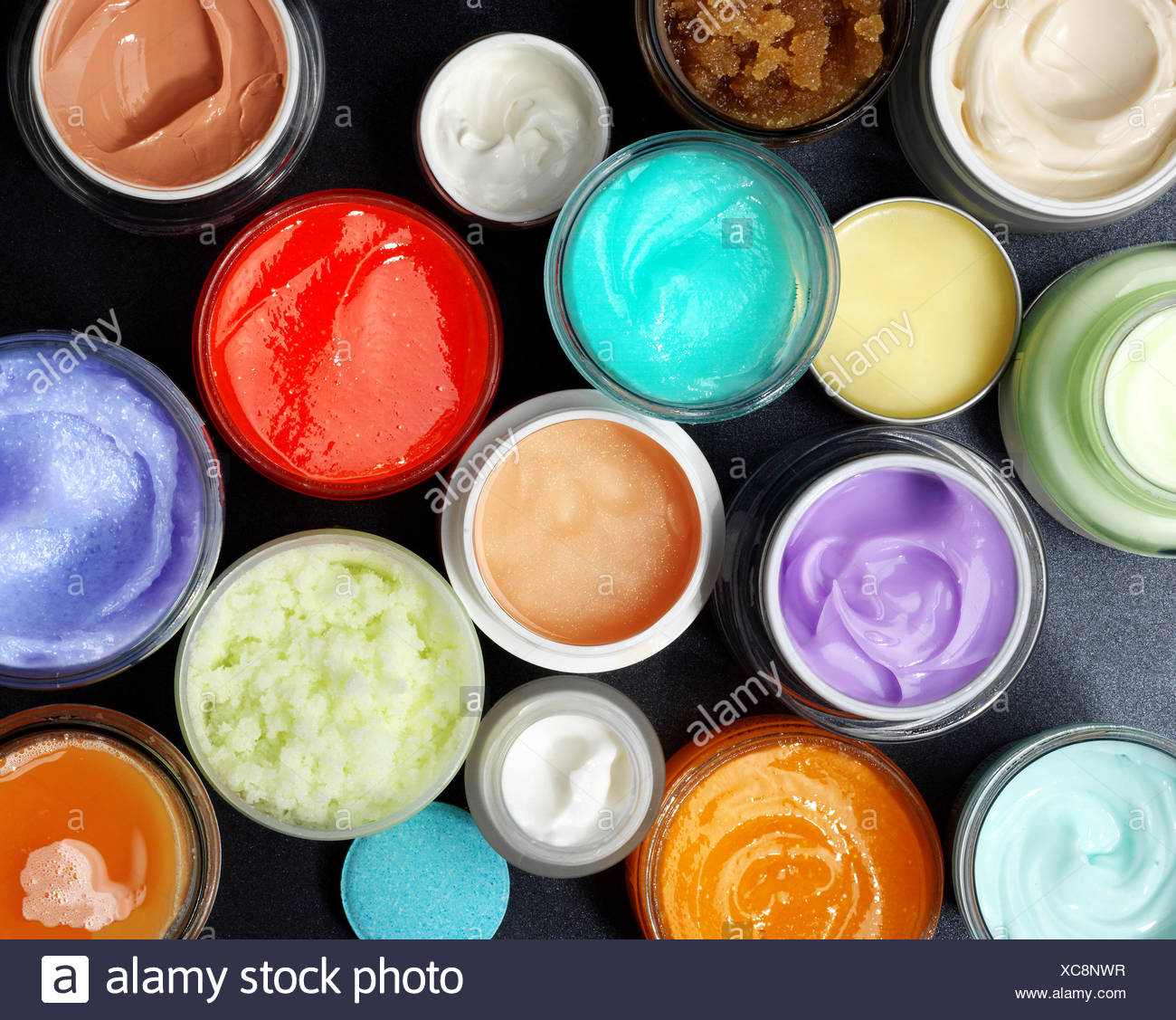 Colorful scrubs and creams - Stock Image