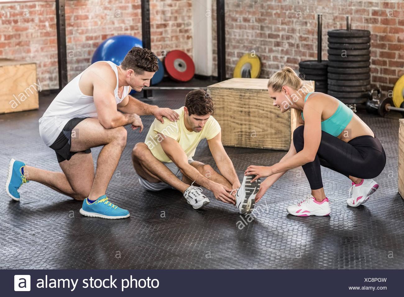 Muscular man having an ankle injury - Stock Image