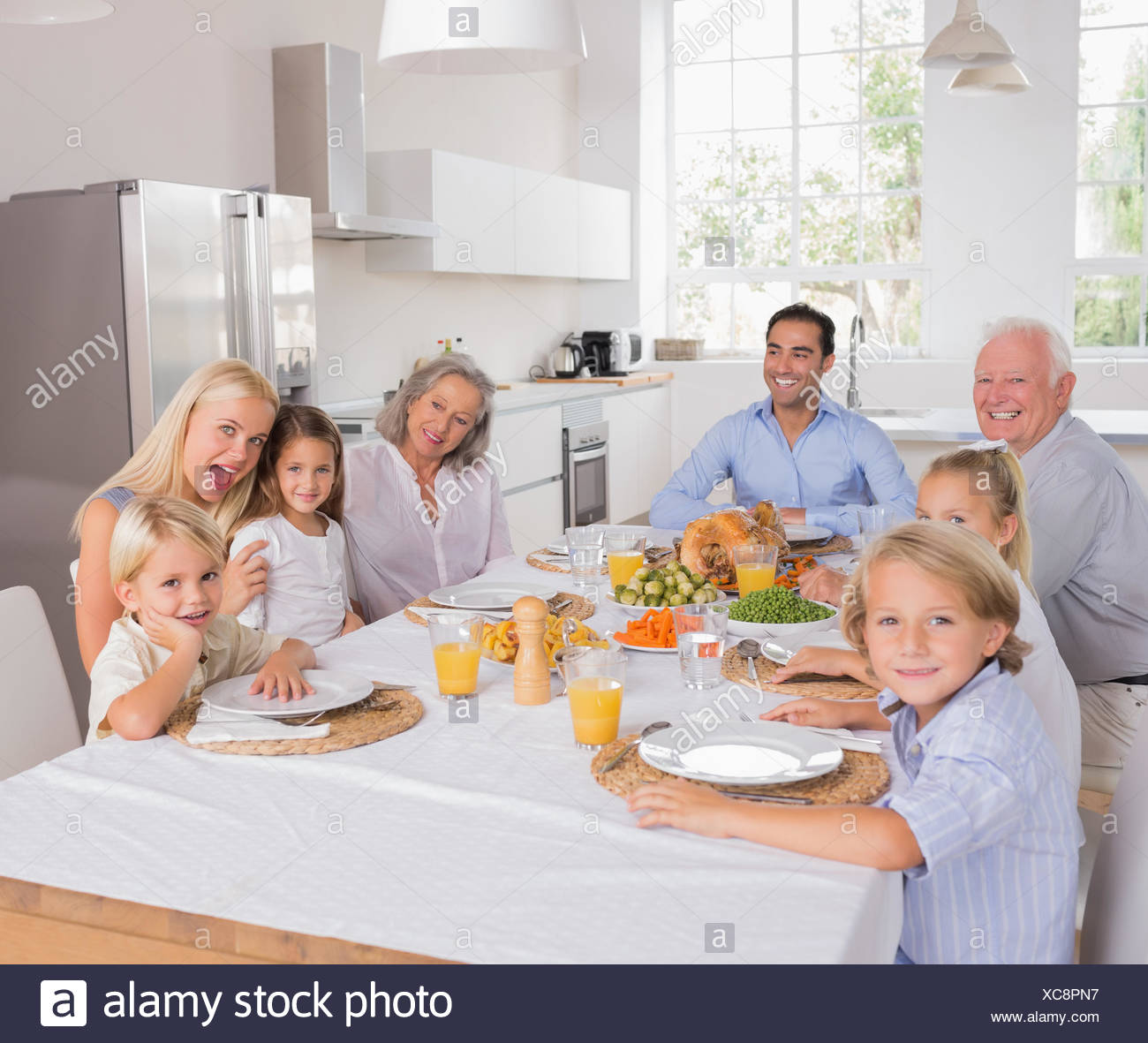 Happy family going to eat - Stock Image