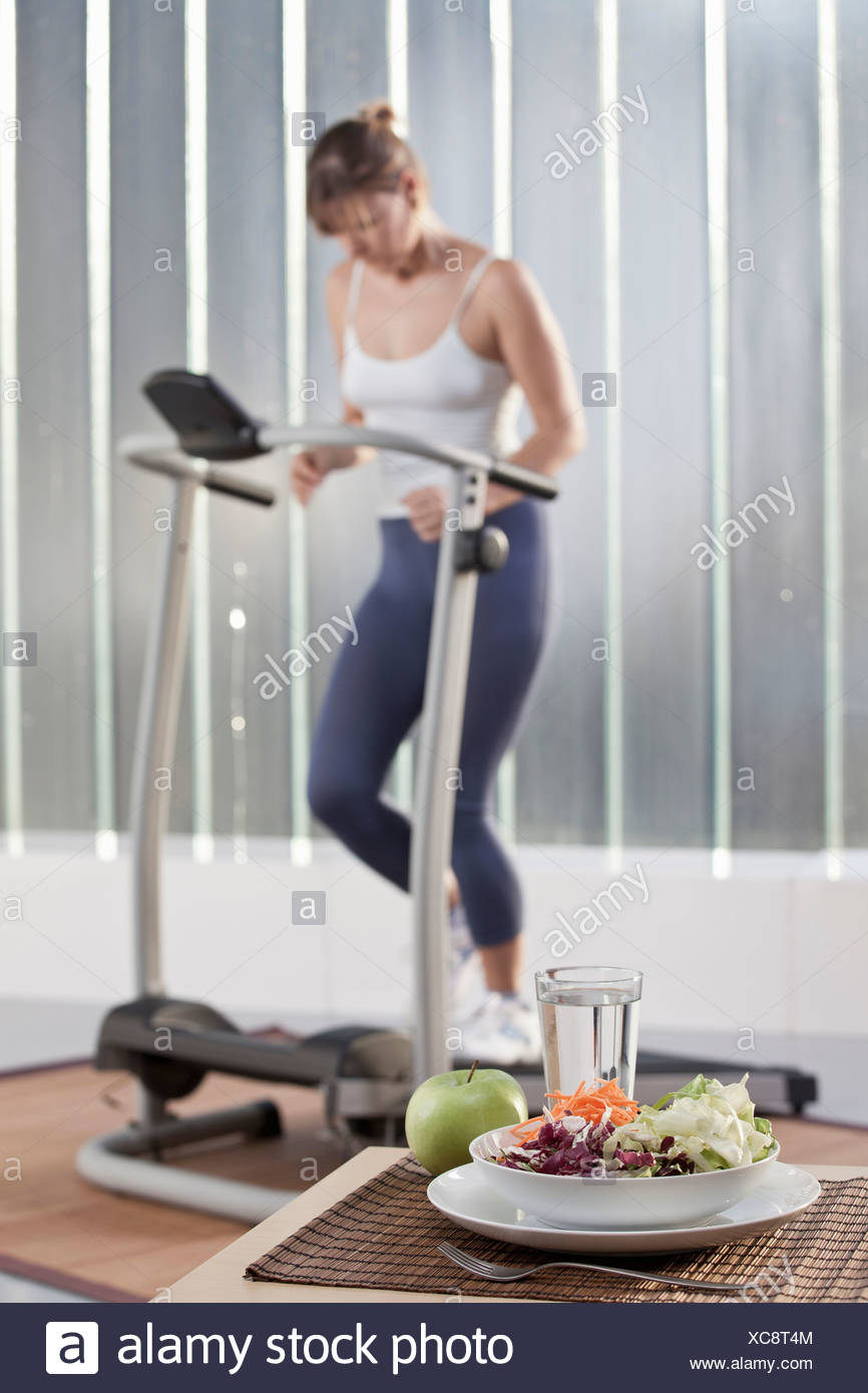 Plate of salad in home gym - Stock Image