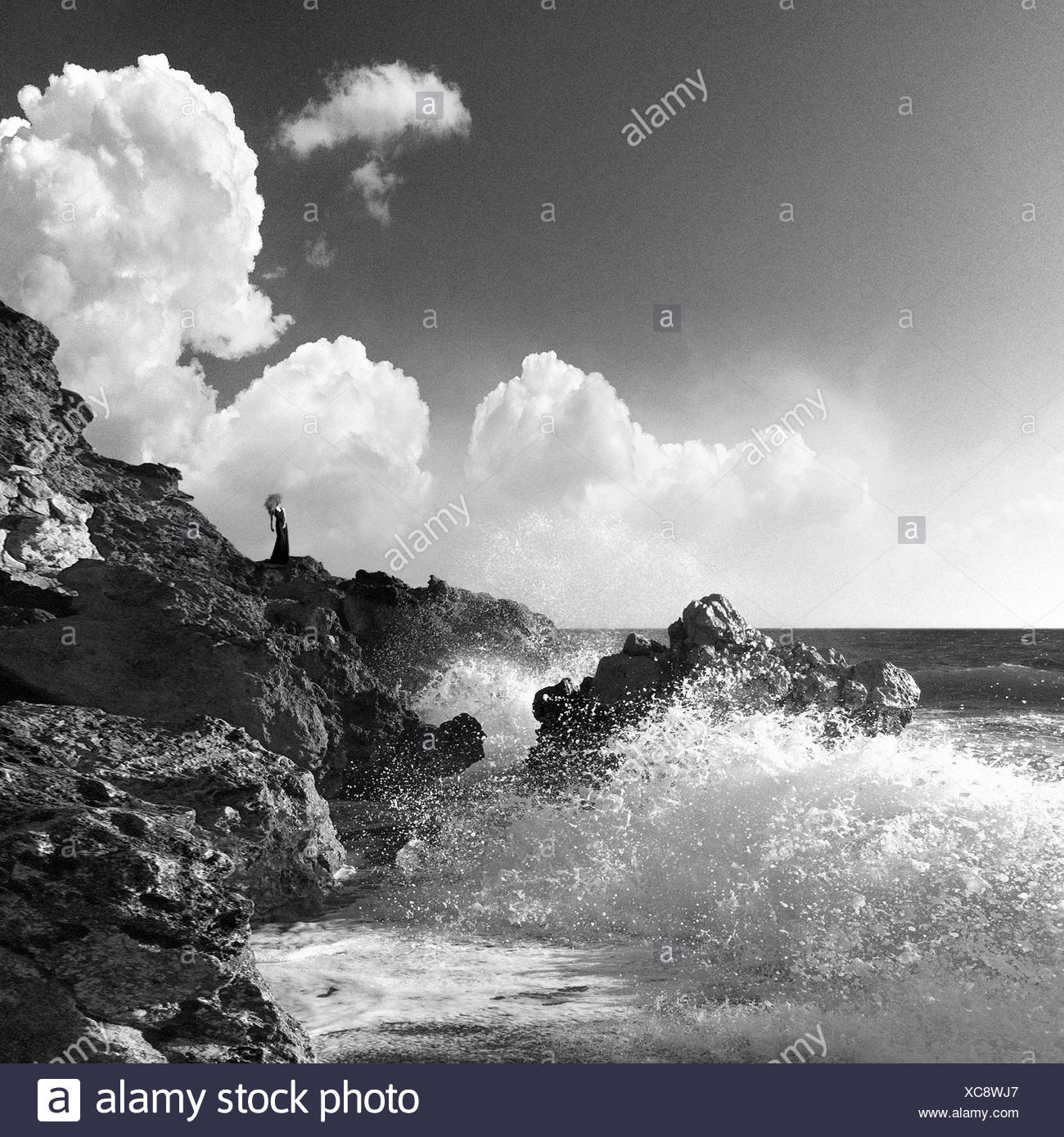 Greece, Peloponnese Periphery, Messenia Prefecture, Kyparissia, Person standing on rocks - Stock Image