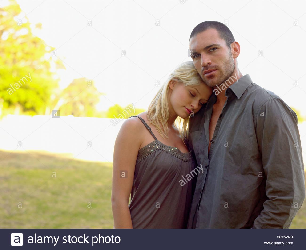 Couple stood outdoors - Stock Image