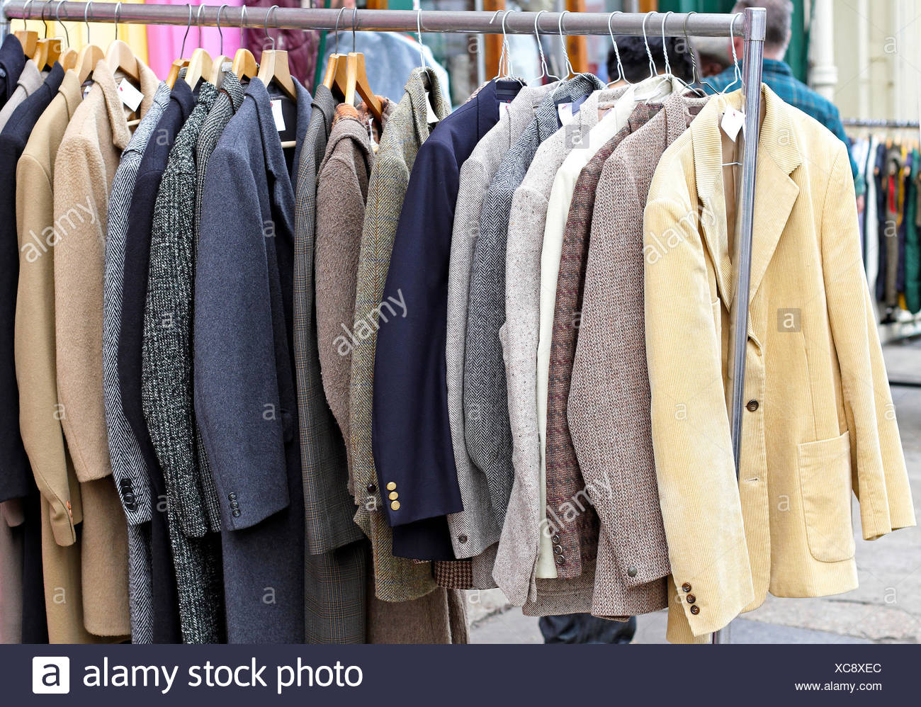 Suits at rail - Stock Image