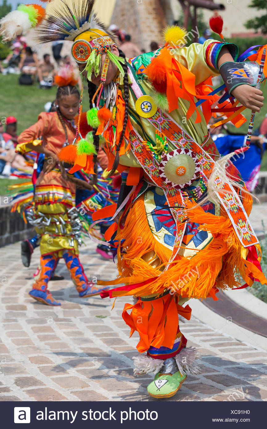 First Nations dancers in traditional dress at a pow wow ceremony, Winnipeg, Manitoba, Canada - Stock Image