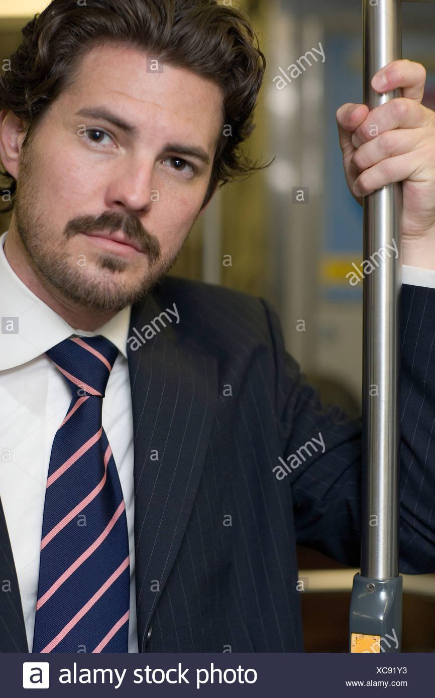 Portrait of businessman in underground train - Stock Image