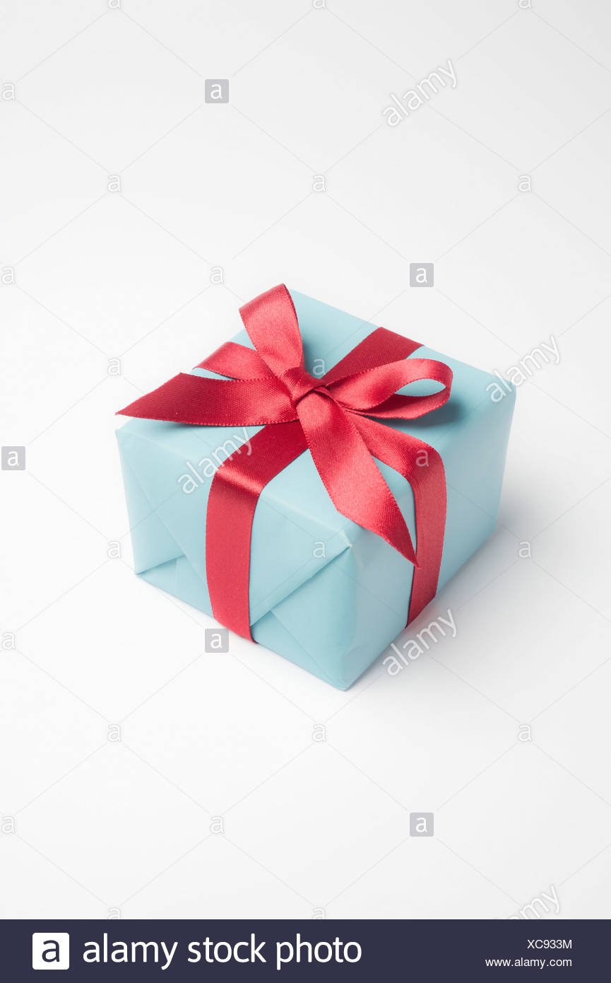 Festively wrapped gift - Stock Image